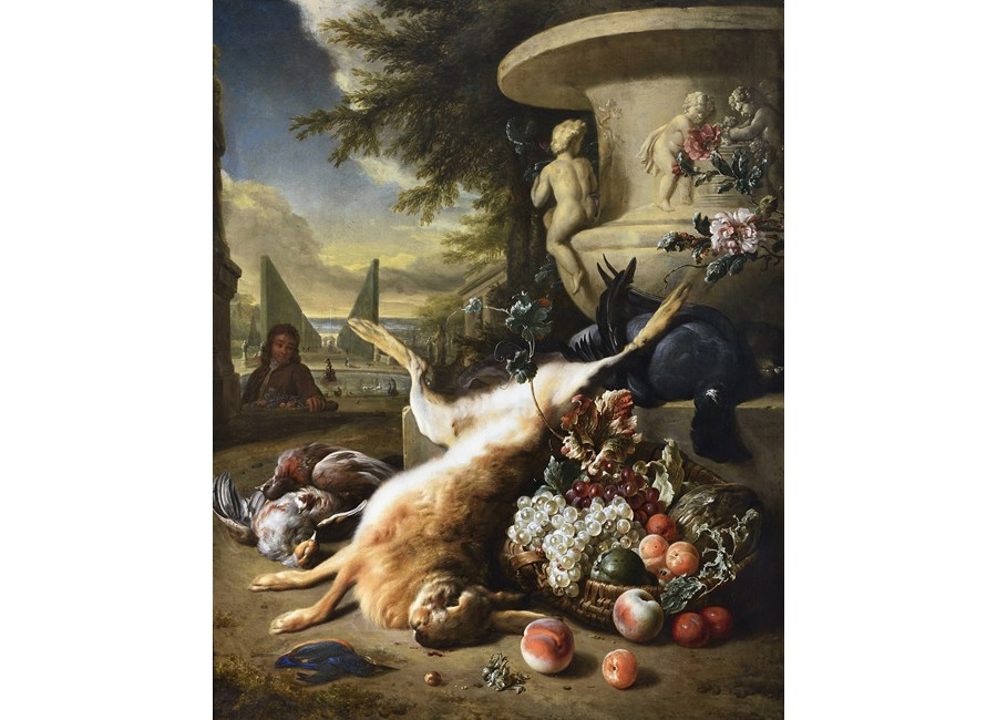 A grouse, kingfisher, and other game birds with a hare and a basket of fruit at the foot of a carved stone urn, an Italianate garden with a fountain beyond